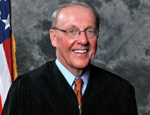 The Honorable D. Michael Fisher